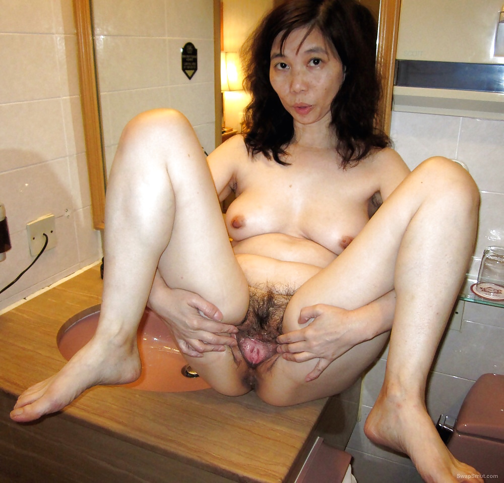 My asian wife showing her goods