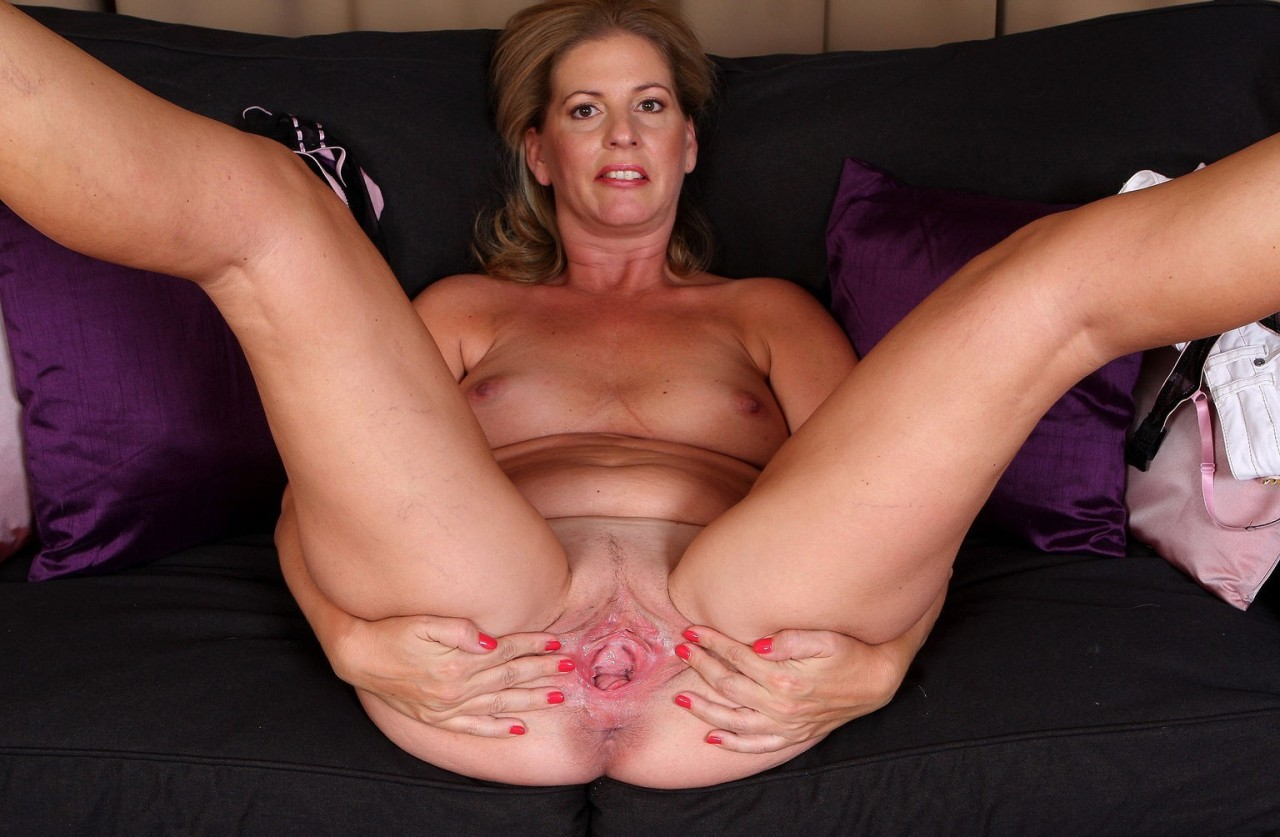 Blonde mature sun lover flashing tits and twat