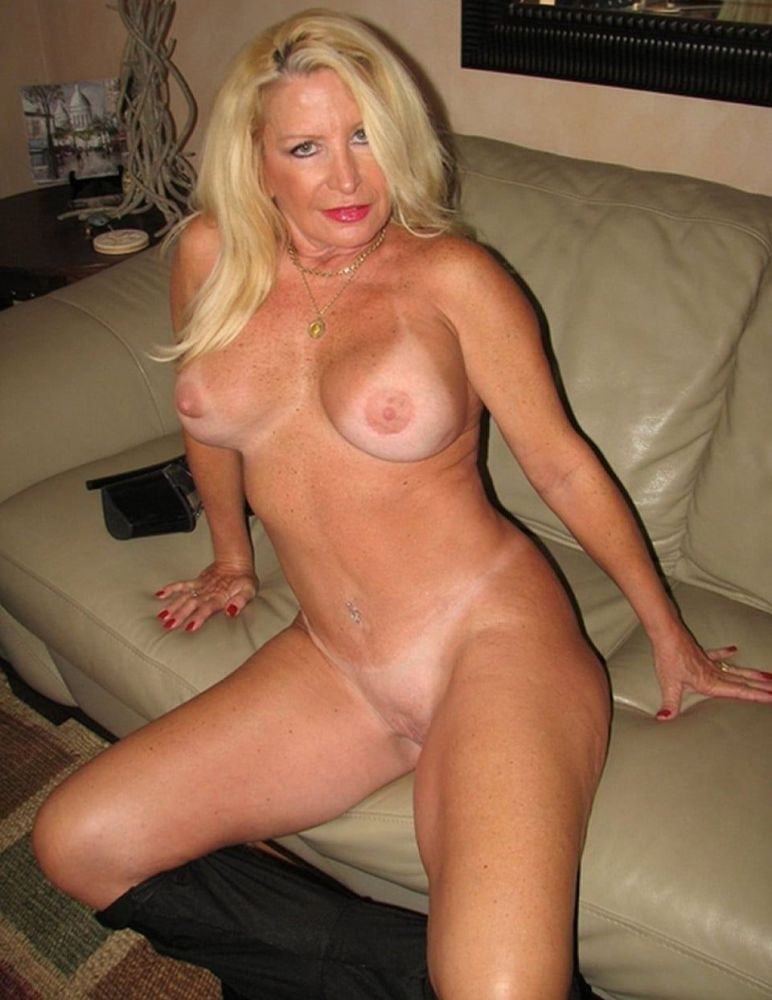 Naked sexy blonde milf on counter